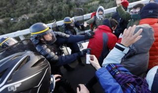 French riot police clash with Catalan independence activists on border with Spain
