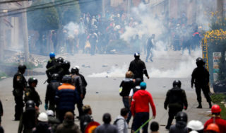 U.S. issues warning on Bolivia as opposition leader claims power