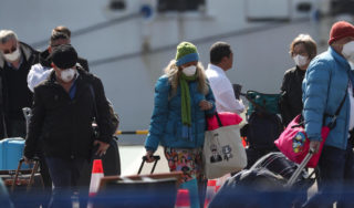 Dozens allowed off virus-hit ship in Japan now showing symptoms