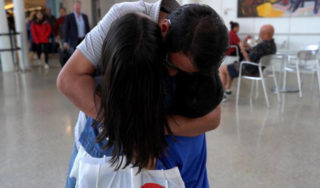 Immigrant father accused of being in a gang reunites with his children