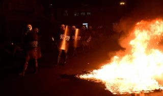 Residents clash with police on Greek islands over building of new migrant detention camps