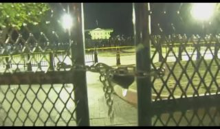 Thousands of protesters gather outside new White House fence