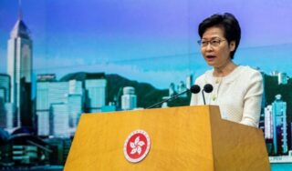 Lam defends security law as Hong Kong police granted new powers