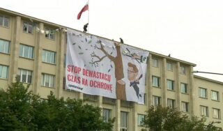 Greenpeace activists climb onto roof of Poland's Environment Ministry in protest