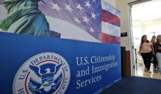 "U.S. reimposes ""public charge"" wealth test for immigrants"