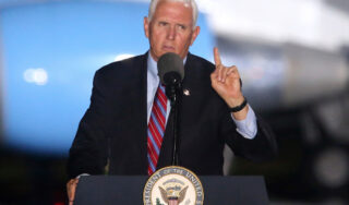 White House defends Pence campaigning after aide's COVID-19 test