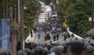 Guatemala troops and police break up caravan of weary migrants trying to reach US