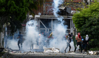 In Pictures: Colombia protests sharpen Cali's class war