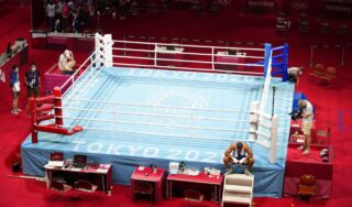 French boxer refuses to leave the ring in disqualification protest