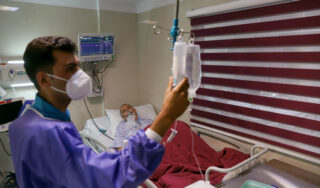 Iran's health minister calls for lockdowns enforced by military