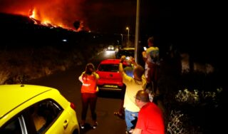 Lava pours from Canary Islands' volcano, villages evacuated